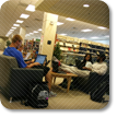 Library Access Button, image of students studying in the library